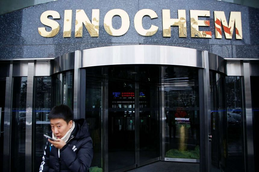 A man walks past the office building of Sinochem in Beijing, China on Feb 21, 2017.
