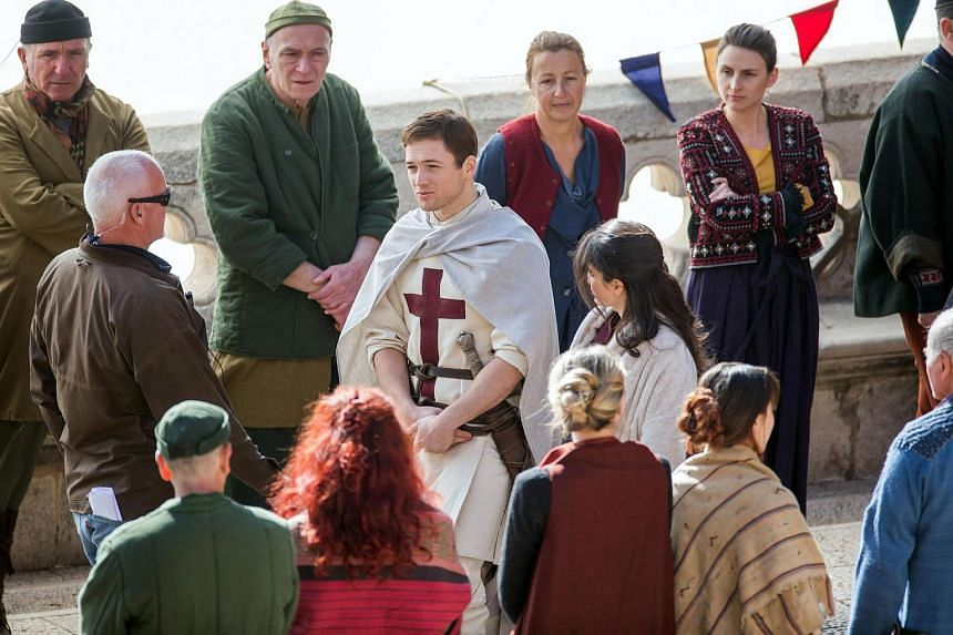Welsh actor Taron Egerton as Robin Hood (centre, left) and Irish actress Eve Hewson as Maid Marian (centre, right) play during the film shooting of Robin Hood: Origins in Dubrovnik, Croatia, on Feb 20, 2017.