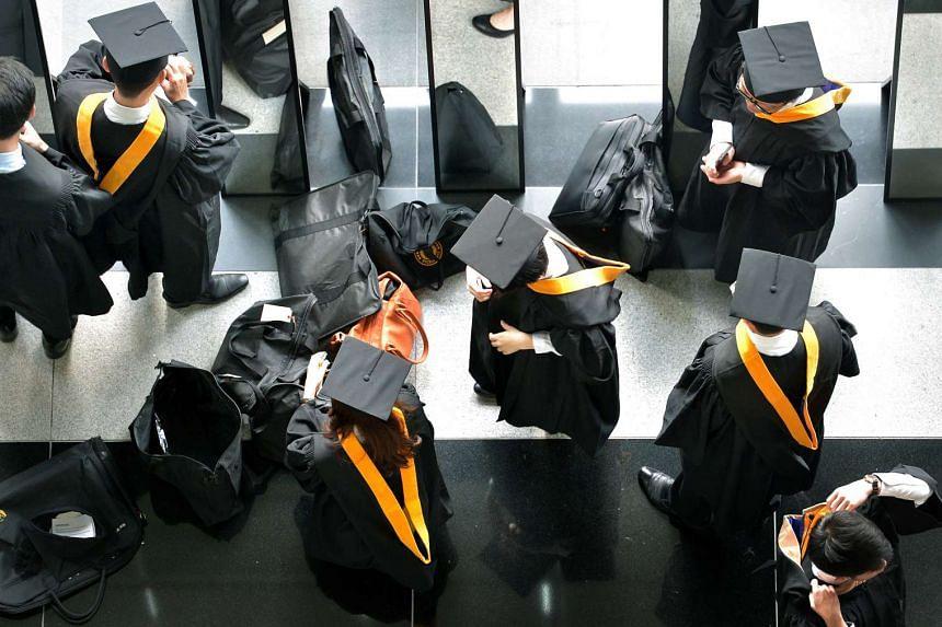 SMU graduates preparing for their graduation ceremony.