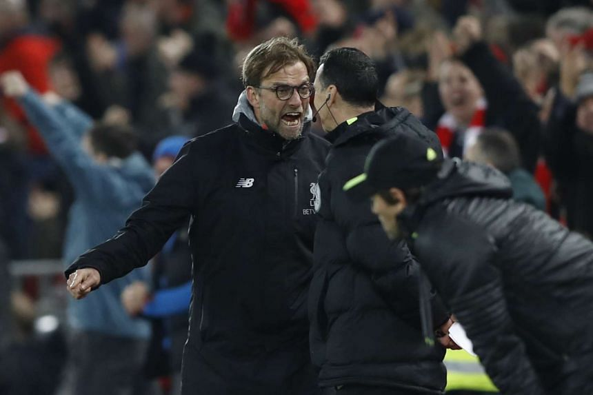Liverpool manager Juergen Klopp remonstrates with the fourth official after Chelsea are awarded a penalty on Jan 31, 2017.