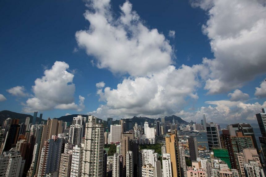 Commercial and residential buildings stand in Hong Kong, on July 21, 2016.
