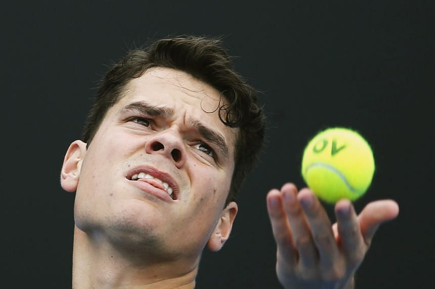 Milos Raonic (above, in a file photo) beat Tim Smyczek 6-1, 6-4.