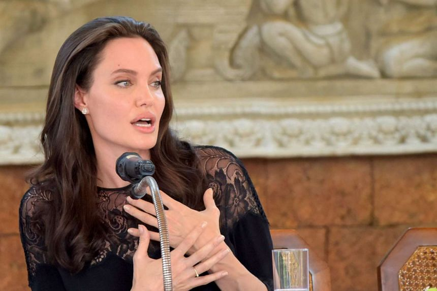 Hollywood star Angelina Jolie speaks to the media during a press conference in Siem Reap, Feb 18, 2017.