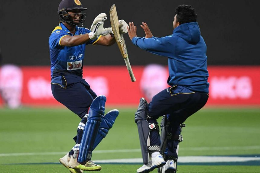Asela Gunaratne of Sri Lanka (left) celebrating with a teammate after scoring the winning run during the second Twenty20 cricket match between Australia and Sri Lanka, on Feb 19, 2017.