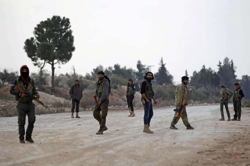 Free Syrian Army fighters with their weapons on the outskirts of the northern Syrian town of al-Bab on Feb 4, 2017.