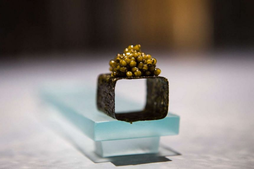 Seaweed with caviar, one of some 40 dishes served during a dining experience at Enigma in Barcelona.