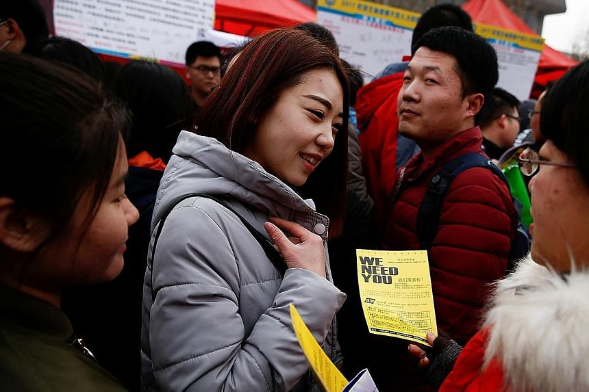 A recruiter handing out a flier to a job seeker in Hebei province. Millennials in China are warming to short-term employment.