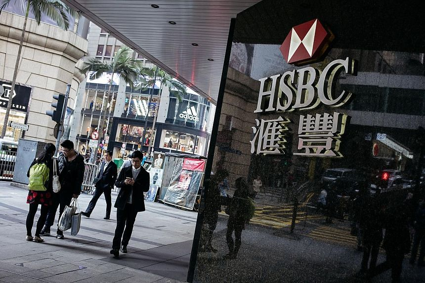 HSBC's pre-tax profit plunges 62% on write-downs, Business