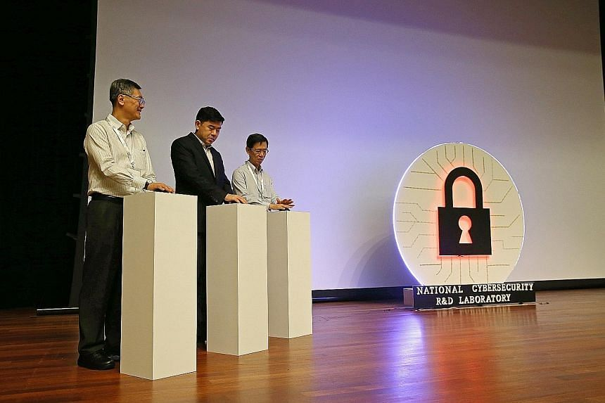 (From left) NUS provost Tan Eng Chye, Permanent Secretary for Communications and Information Gabriel Lim and National Cybersecurity R&D Laboratory governing board chairman Quek Gim Pew at the launch yesterday.