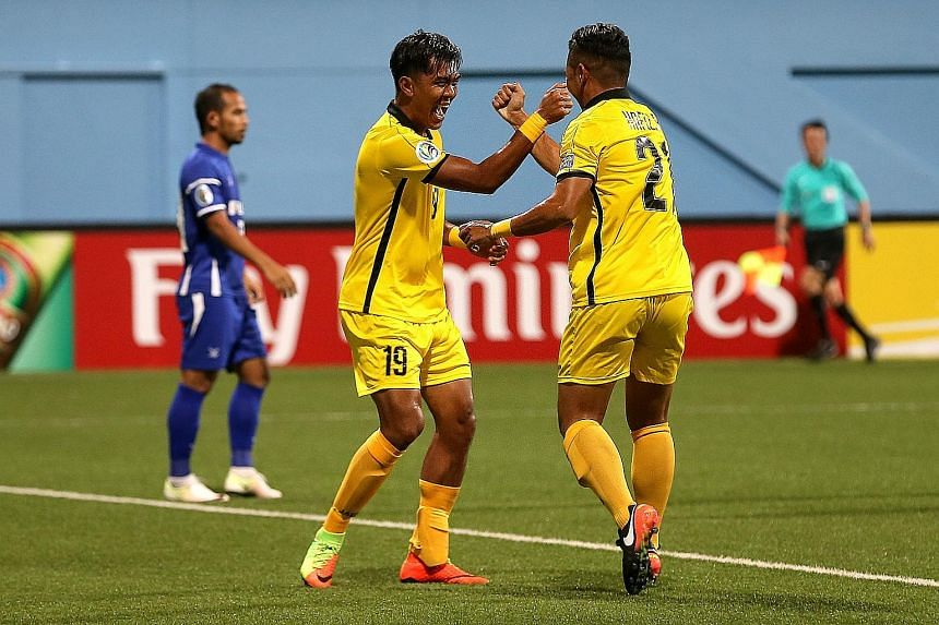 Tampines striker Khairul Amri celebrates his winner with team-mate Hafiz Rahim. He took 12 minutes to score the first goal of his third spell at the club.