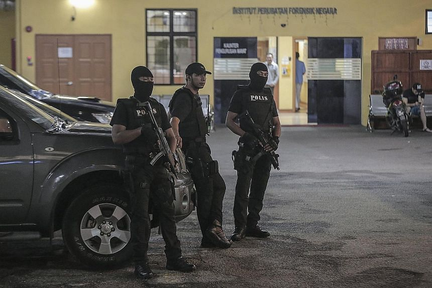 Royal Malaysian Police special operations forces on guard yesterday at the morgue of Hospital Kuala Lumpur, where Mr Kim's body is being kept.