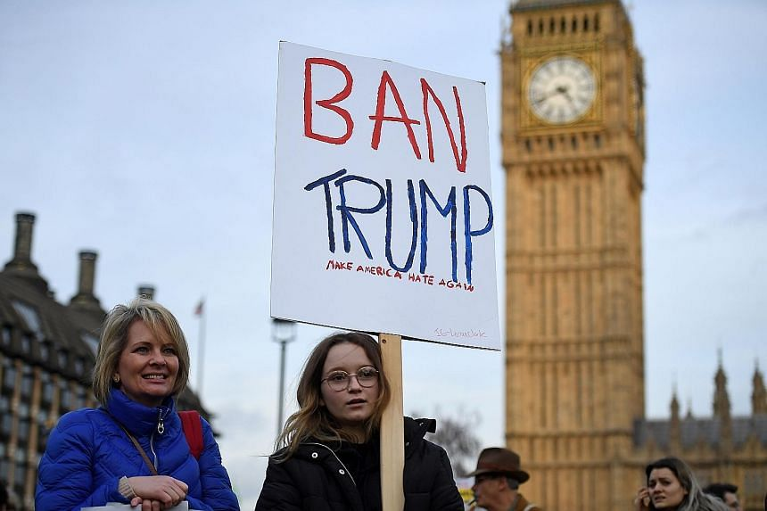 """Protesters outside the British Parliament on Monday demonstrating against the planned state visit of US President Trump later this year. The government says it wants to reaffirm the """"special relationship"""" with the US and secure a trade deal as Britai"""