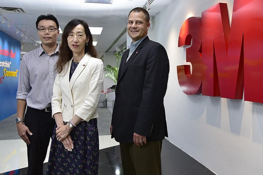 Ms Yuko Nakahira, managing director of 3M; Mr Eugene Chew, senior manager of 3M's Tuas plant; and Mr Mark Ratzlaff, South-east Asia regional manufacturing operations manager, 3M Southeast Asia Region.