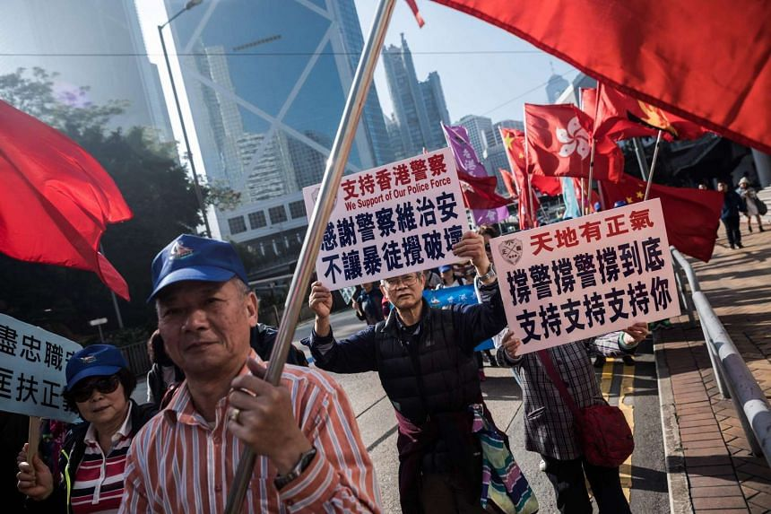 Supporters of the seven police officers march along a road during a rally in Hong Kong on Feb 18, 2017.