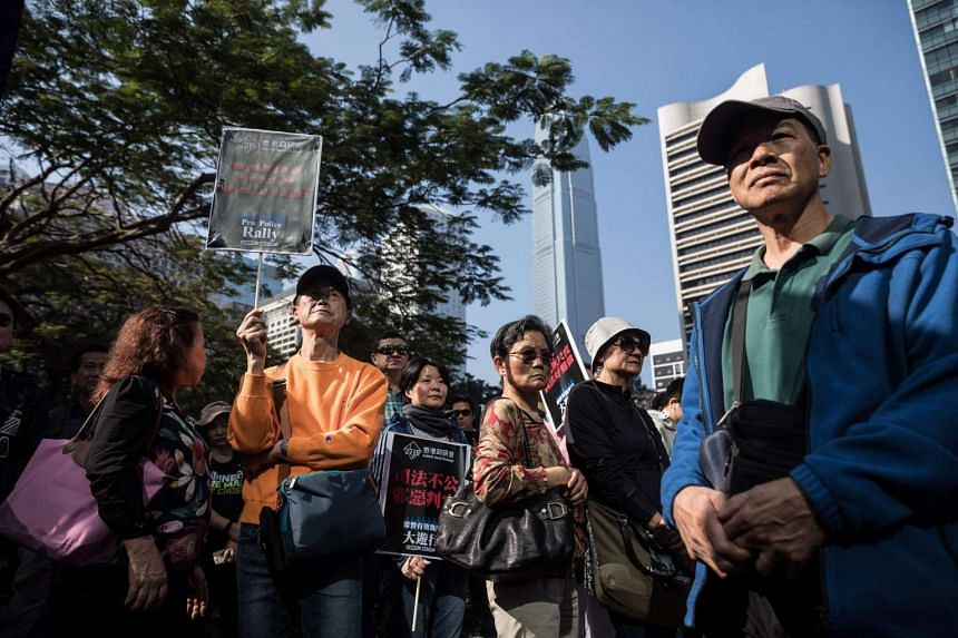 Supporters of the seven police officers attend a rally in Hong Kong on Feb 18, 2017.