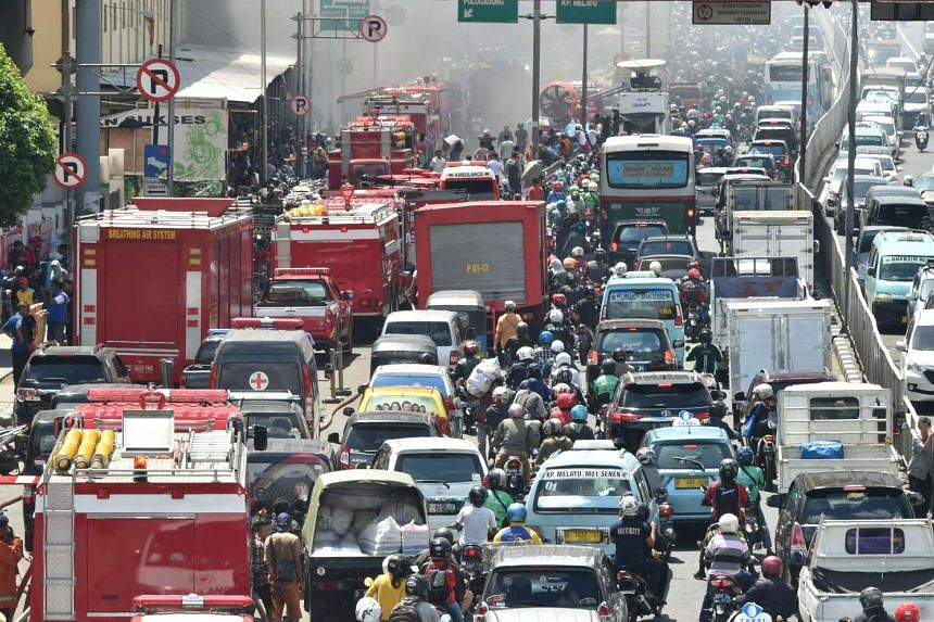 Motorists stuck in a traffic jam in Jakarta after a fire broke out at one of the city's biggest shopping centres last month. The Indonesian capital was ranked No. 22 among the cities with the worst traffic congestion.