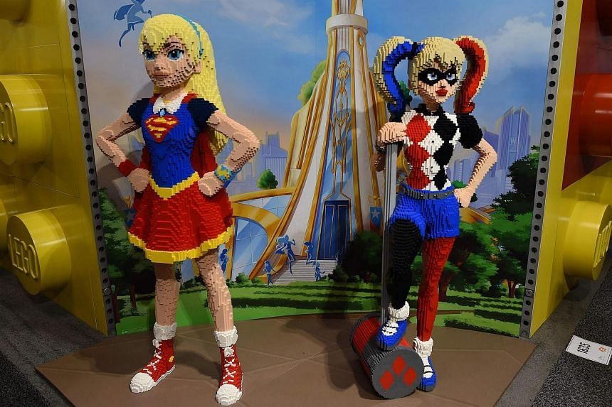 Lego SuperGirl and Harley Quinn on display at the American International Toy Fair in New York on Feb 19, 2017.