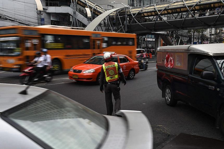 A Thai traffic policeman observing the traffic in Bangkok on Jan 5, 2017.