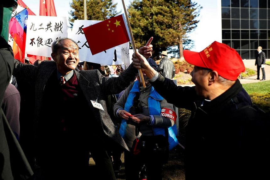 A supporter of Taiwan President Tsai Ing-wen (left) arguing with a supporter of China (right) during a demonstration at a stop-over after her visit to Latin America in Burlingame, California, US, on Jan 14, 2017.