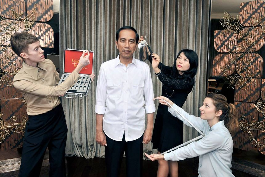 "Indonesian President Joko ""Jokowi"" Widodo being measured by Madame Tussauds' sculpting team and artists at the State Palace in Jakarta."