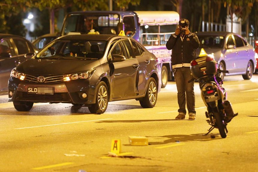 A motorcyclist died after he crashed into a car door that suddenly opened while the car was stopped at a traffic light on Feb 22, 2017.