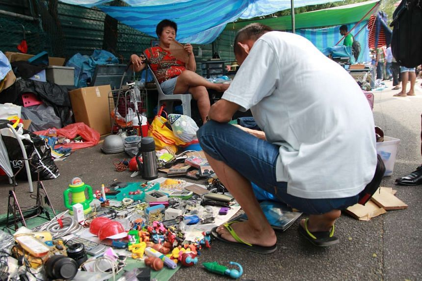 A vendor selling her wares at the Sungei Road flea market.
