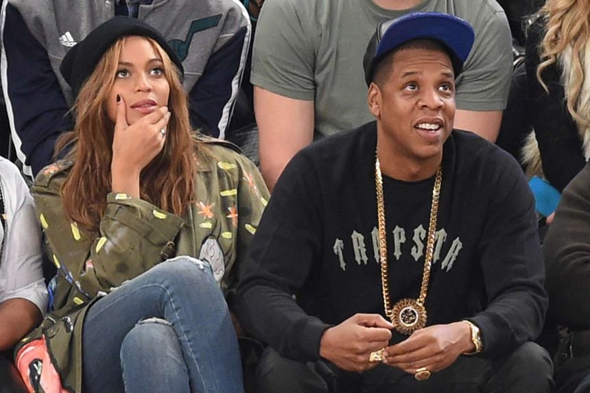 Jay Z and wife Beyonce attend a basketball game in New York in a 2015 file photo.