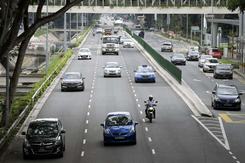 Vehicles travelling along Upper Bukit Timah Road. Certificates of Entitlement (COE) ended higher across the board on Friday, Feb 24, 2017, after announcement of higher taxes for high-end motorcycles and a probable dip in the Open COE supply.