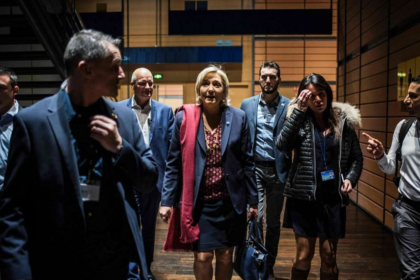 Le Pen (fourth right) arrives for a two-day political rally to kick off her presidential campaign, next to her chief of staff Catherine Griset (second right) and bodyguard Thierry Legier (third left).