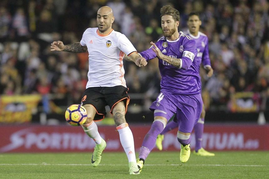 Real Madrid's Sergio Ramos (right) and Valencia's Simone Zaza in action at Mestalla stadium, on Feb 22, 2017.