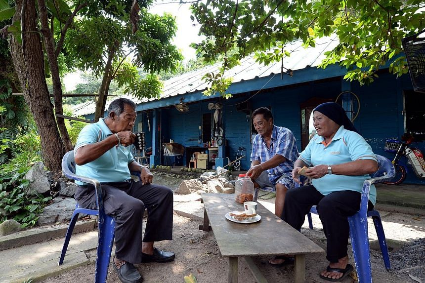 Three of the remaining islanders are (from left) Mr Supar, Mr Sulih and Madam Fauziyah. The Straits Times understands they will get to continue living in the former staff quarters, and that the matter of an allowance is being discussed.