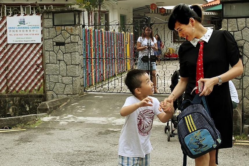 Housewife Amy Deng, 33, fetching her five-year-old son from Sam's Early Learning Centre on Tuesday afternoon. The boy has been attending the childcare centre for more than two years.