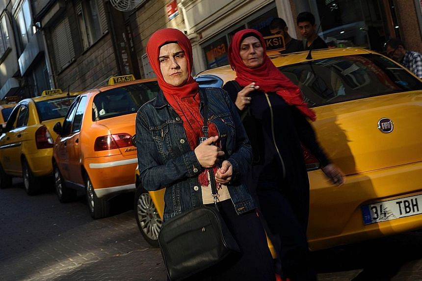 President Recep Tayyip Erdogan's party has long pressed for the removal of restrictions on the wearing of the headscarf - a contentious argument in Turkey, which was established as a secular republic in 1923.
