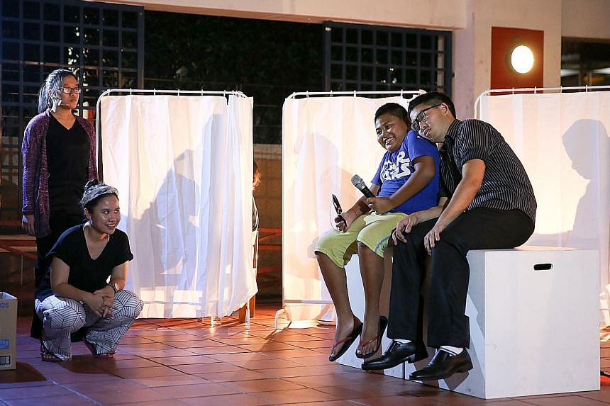 Beyond Social Services community worker Noor Izzaty Ishak (second from left) watching as programme participant Suffrie Sarifee, 10, takes part in a short demonstration before the Sayang forum theatre piece. The play explores issues faced by the renta