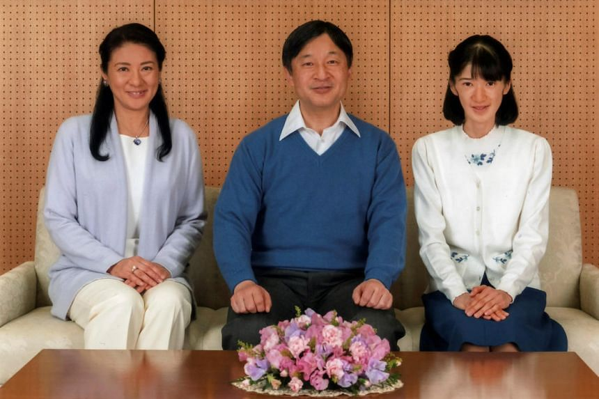 Japan's Crown Prince Naruhito poses for a photo with Crown Princess Masako (L) and their daughter Princess Aiko at Togu Palace in Tokyo, Japan, February 12, 2017, in this handout photo released by Imperial Household Agency of Japan. Naruhito celebrat