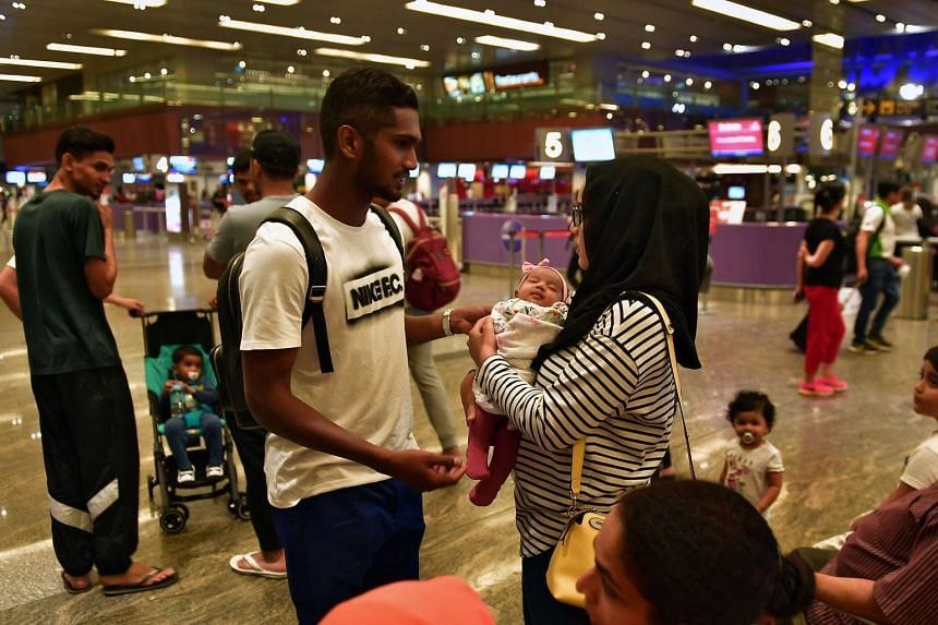Lions vice-captain Hariss Harun at the airport, preparing to leave for Europe to spend a year with Spanish side Centre d'Esports L'Hospitalet.