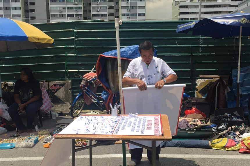 Mr Koh Ah Koon, 76, the president of the Association for the Recycling of Second Hand Goods, who printed the banners.
