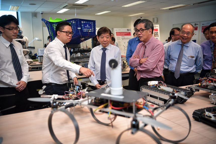 Transport Minister Khaw Boon Wan tours the Systems Engineering Lab at the official launch of the Singapore Rail Academy.