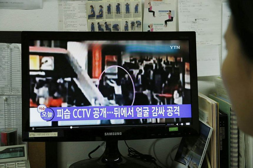 A South Korean watches a TV news report allegedly showing the assassination of Kim Jong Nam.