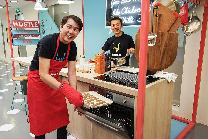 CapitaLand's president & group CEO, Mr Lim Ming Yan (left), and Ascott's CEO, Mr Lee Chee Koon, trying their hand at baking at Lyf's 'Bond' social kitchen.