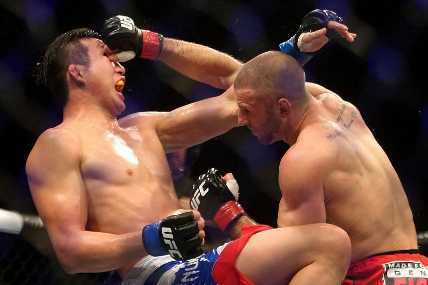 File photo of Belgium's Tarec Saffiedine (right) against Korea's Lim Hyun Gyu in the first Ultimate Fighting Championship show in Singapore at the Marina Bay Sands on Jan 4, 2014.