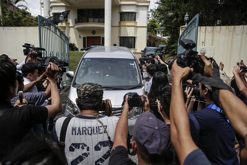 Members of the media surrounding a North Korean official's car at the North Korean embassy in Kuala Lumpur, Malaysia, on Wednesday (Feb 22).