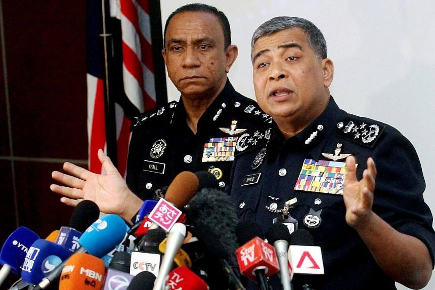 Malaysia's Inspector-General of Police Khalid Abu Bakar (right) holding a press conference on Mr Kim Jong Nam's death.