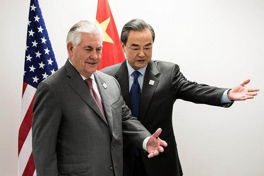 US Secretary of State Rex Tillerson (left) and China's Foreign Minister Wang Yi at a gathering of foreign ministers of the G20 leading and developing economies at the World Conference Center in Bonn, Germany, on Feb 17, 2017.