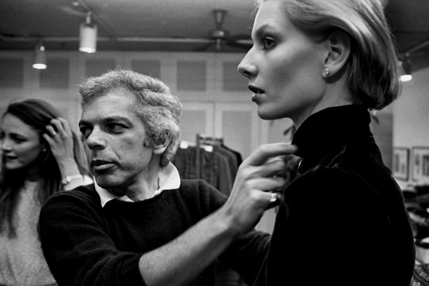 March 1980: Ralph Lauren (left) prepping a model in his showroom and designer Calvin Klein in his Seventh Avenue studio.