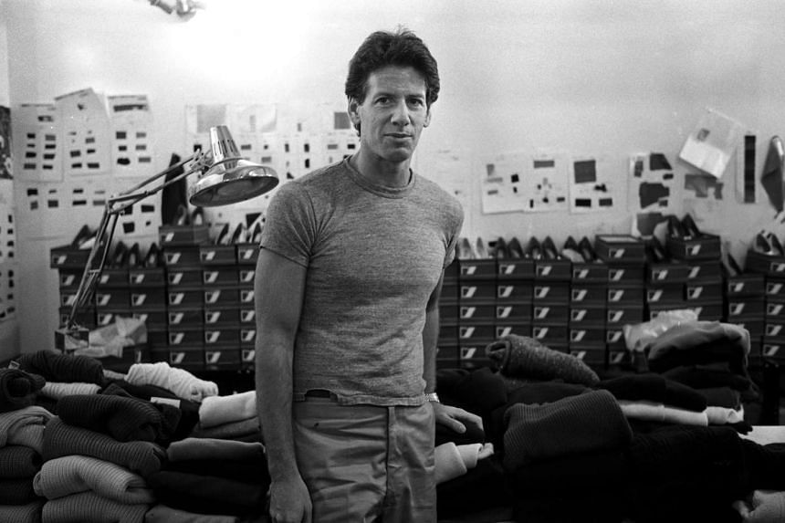 March 1980: Ralph Lauren prepping a model in his showroom and designer Calvin Klein (above) in his Seventh Avenue studio.