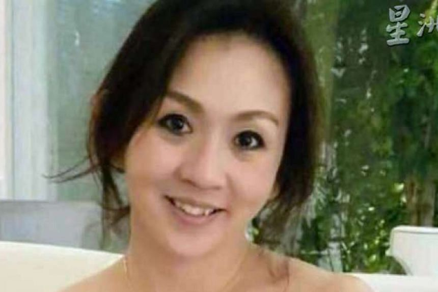 Ms Lee (above), who worked in the shipping and logistics industry, was found dead in her white BMW after a gunman fired 10 shots, six of which struck her, on Tuesday.