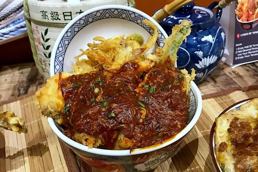 The Spicy Chilli Crab Tendon offers chunks of snow crab.