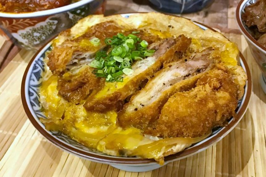 The Mille Feuille Katsu Don is actually a patty made out of 14 slices of thin pork loin layered one on top of another.