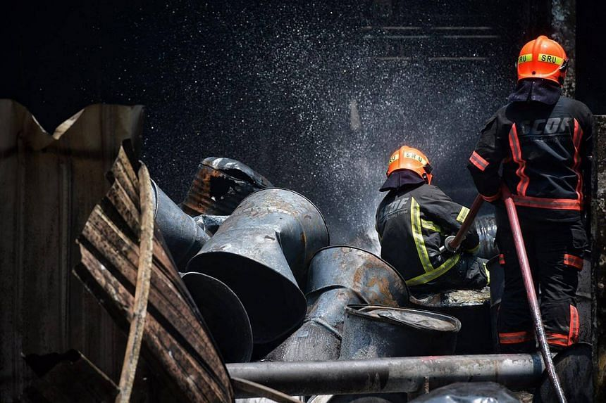 SCDF officers are currently damping down the site to prevent potential rekindling of fire from the hot, burnt surfaces.
